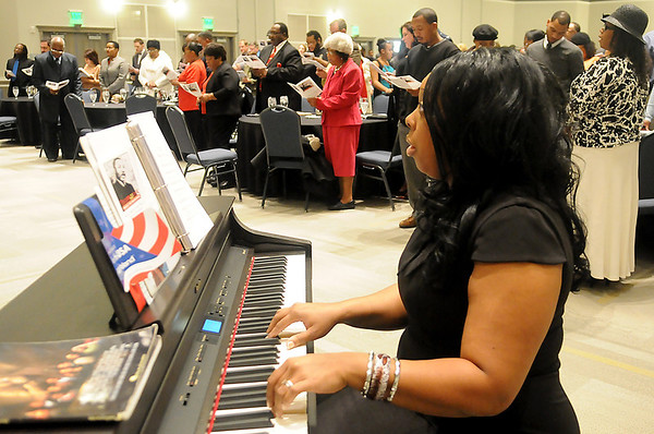 """Ja-Nell Huff accompanies the Community Choir and guests as they perform  """"Lift Every Voice and Sing"""" Sunday during the 25th annual Dr. Martin Luther King, Jr. Holiday Celebration in the Convention Hall Grand Ballroom. (Staff Photo by BONNIE VCULEK)"""