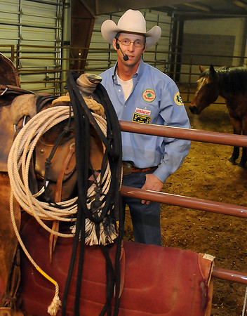 Scott Daily, a horse training expert, pauses inside a corral during the 17th annual KNID Agrifest Saturday at the Chisholm Trail Expo Center. Daily presented training seminars at 11 a.m. and 3 p.m. daily. (Staff Photo by BONNIE VCULEK)