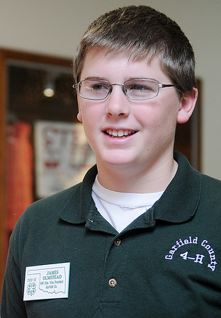James Olmstead, the Northwest District Vice President for Garfield County 4-H, enjoys the 4-H Day festivities at Oakwood Mall Saturday. (Staff Photo by BONNIE VCULEK)