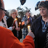 Dayna Baker (right) shares the light of her candle with family and friends Tuesday, Jan. 22, 2013, as they gather at Meadowlake Park North to remember Heath Crites, who was murdered at his home on Dec. 22, 2012. The Enid Police Department continues their investigation of the unsolved murder. (Staff Photo by BONNIE VCULEK)