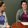 Amanda Stinnett (right), an exercise physiologist, describes the support she and Jessica Lenherr (left) provide cardiac rehab patients at St. Mary's Regional Medical Center. (Staff Photo by BONNIE VCULEK)