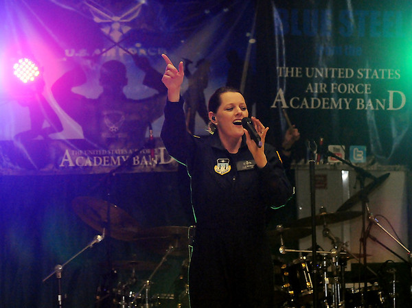 TSGT. Julie Bradley sings vocals during the United State Air Force Academy's Blue Steel performance at Emerson Middle School Wednesday. More than 400 Irish students, who had grades no less than a C, were able to attend the special event. (Staff Photo by BONNIE VCULEK)