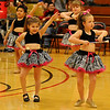 Enid Twirling Academy Thunderbirds Juvenile Corps entertains the crowd during half-time festivities at the Enid High School basketball games in the Mabee Center Thursday, Jan. 31, 2013. The group is under the direction of Belva Lamb. (Staff Photo by BONNIE VCULEK)