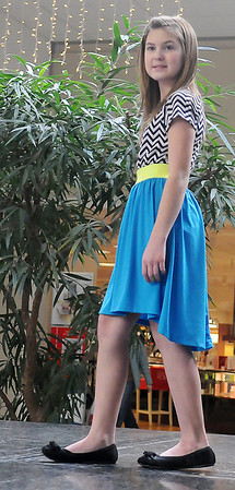 Kaitlyn Booth, from Garber, models during the Garfield County 4-H Day style show Saturday at Oakwood Mall. (Staff Photo by BONNIE VCULEK)