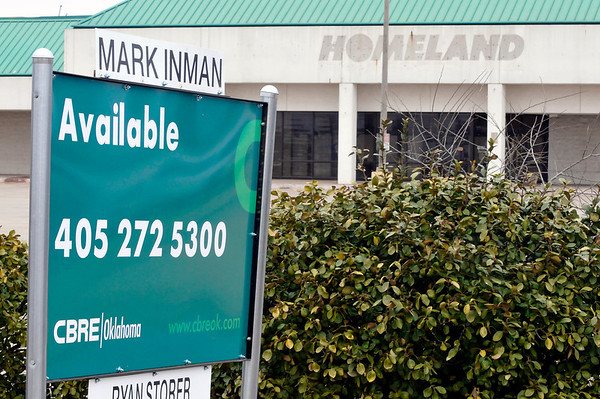Real estate sign in front of the former Homeland building on W. Garriott Tuesday. A commercial real estate firm has been contracted to market and close lease contracts on the building. (Staff Photo by BILLY HEFTON)