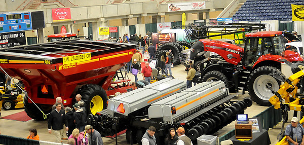 KNID Agrifest guests tour the displays Saturday during the 17th annual event at the Chisholm Trail Expo Center. (Staff Photo by BONNIE VCULEK)