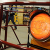 A VAL 6 Infra-Red Oil Heater (right) warms the breeze way during the KNID Agrifest 2013 Friday at the Chisholm Trail Expo Center. (Staff Photo by BONNIE VCULEK)