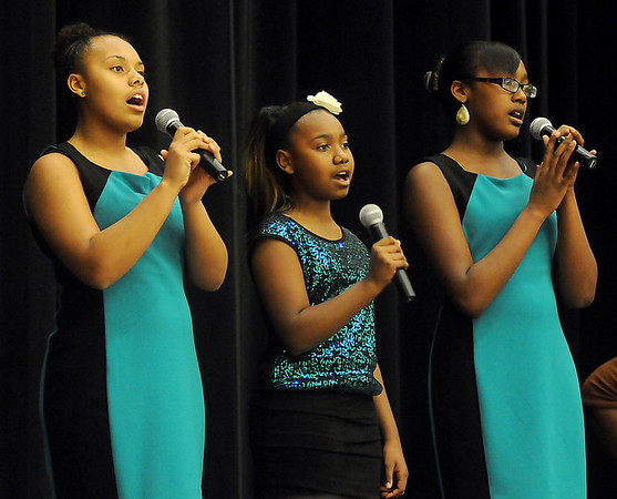 Angelic Voices sing The National Anthem Sunday during the 25th annual Dr. Martin Luther King, Jr. holiday celebration at Convention Hall. (Staff Photo by BONNIE VCULEK)