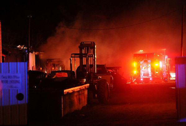 At approximately 11:04 p.m., Enid firefighters extinguish a blaze in a rear building at 3321 N. 4th Thursday, Jan. 31, 2013. The Enid Fire Department, North Enid Police Department and Garfield County Sheriff Department were at the scene. (Staff Photo by BONNIE VCULEK)
