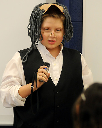 Owen Killam portrays Benjamin Franklin during Desiree Highberger's fifth grade class re-enactments Thursday at Monroe Elementary School. (Staff Photo by BONNIE VCULEK)