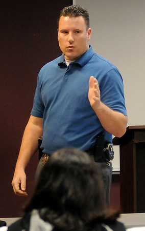 Det. Jeff Weber, with the Enid Police Department, discusses domestic violence during the Safe For Me presentations at Northwestern Oklahoma State University in Enid Saturday, Jan. 26, 2013. The program was designed for teens aging out of foster care. (Staff Photo by BONNIE VCULEK)
