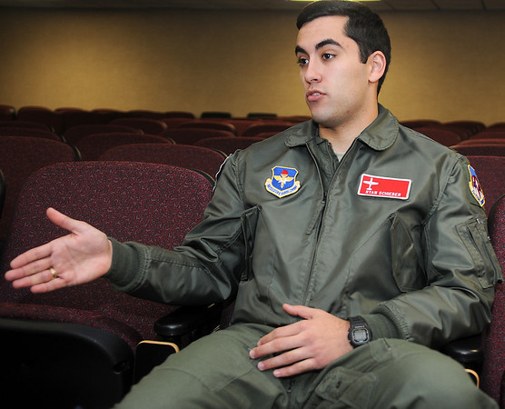 2nd Lt. Ryan Schieber explains the tight flying formations that pilots in the Vance Air Force Base 71st Flying Training Wing Class 13-13 are performing with their instructor pilots. Schieber and several members of the class are currently on track for T-1 pilot training. (Staff Photo by BONNIE VCULEK)