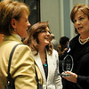 The Enid News & Eagle 2012 Pillar of the Plains award winner, Martie Oyler (right) receives congratulations from Sharon Trojan, Andi Holland and April Danahy during a reception honoring the nominees at the Convention Hall Junior Ballroom. Oyler, Gary Kirtley, Dr. David Russell, Rick Simpson and Larry Simpson were this year's nominees during the event. (Staff Photo by BONNIE VCULEK)