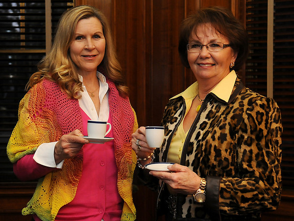 Kelly Champlin (left) and Enid Symphony board member, Ruth Dobbs, pause in the dining room at Champlin Mansion Wednesday, Jan. 16. One of the auction items available Jan. 25 during the symphony's annual gala is an Easter Tea for 20 guests hosted by Kelly Champlin at the Champlin Mansion. (Staff Photo by BONNIE VCULEK)