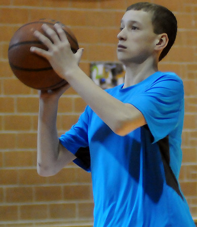 Chisholm's Colton Wichert shoots 11 of 15 free throws during the annual Knights of Columbus free throw shooting competition Saturday, Jan. 19, 2013, at St. Joseph Catholic School. Boys and girls, ages 10-14, participated during the event. (Staff Photo by BONNIE VCULEK)