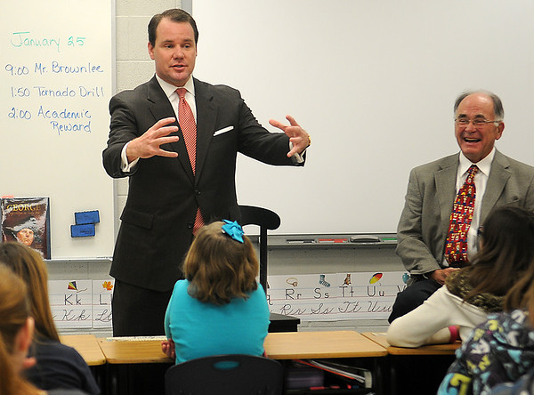 Oklahoma Lt. Gov. Todd Lamb (top, left) recalls a humorous moment during his tenure as a secret service agent for President George W. Bush Friday, Jan. 25, 2013, at McKinley Elementary School. Lt. Gov. Lamb visited fifth grade students at his former alma mater during a special session with mentor, Stan Brownlee (top right). (Staff Photo by BONNIE VCULEK)