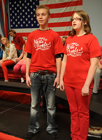 """Dylan Stanly, from Waller Middle School, and Rachael Killiam, from Emerson Middle School sing, """"Oh, Freedom,"""" Tuesday, Jan. 29, 2013, during a rehearsal for the Waller Middle School musical, We The People. (Staff Photo by BONNIE VCULEK)"""
