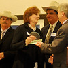Martie Oyler (center) accepts the 2012 Pillar of the Plains award from Enid News & Eagle Publisher Jeff Funk Thursday during a reception at the Convention Hall Junior Ballroom. Other nominees for the honor included Larry Simpson (left), Rick Simpson (second from right), Gary Kirtley and Dr. David Russell. (Staff Photo by BONNIE VCULEK)