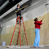 Amy Ratzlaff, Kim O'Neill and Brenda Rogers (from left) paint interior walls at the new Junior Welfare League Return Engagement location Saturday. The organization's official move is slated for Jan. 19-20. (Staff Photo by BONNIE VCULEK)