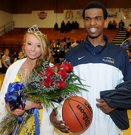 Enid High School basketball homecoming queen, Shannon Mueller (left) and king, Darnae Banks, walk off the court following the half-time festivities at the Mabee Center Tuesday, Jan. 29, 2013. (Staff Photo by BONNIE VCULEK)