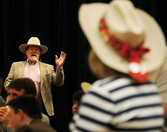 Errol Wofford asks other Enid Noon AMBUCS' Big Hat members several questions during the weekly meeting at the Northern Oklahoma College-Enid Gantz Center Friday, Jan. 25, 2013. (Staff Photo by BONNIE VCULEK)