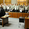 District Judge Paul Woodward swears in Garfield County Deputies Wednesday at the Garfield County Courthouse. (Staff Photo by BILLY HEFTON)