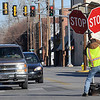 A city employee positions a four way stop sign in the intersection of Broadway and Washington Sunday due to malfunctioning traffic lights. (Staff Photo by BILLY HEFTON)