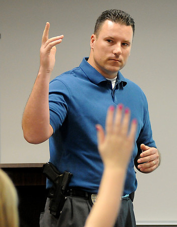 Det. Jeff Weber, with the Enid Police Department, asks teens to raise their hands if they had ever witnessed domestic violence. Safe For Me presentations at Northwestern Oklahoma State University in Enid Saturday, Jan. 26, 2013, were designed for teens aging out of foster care. (Staff Photo by BONNIE VCULEK)