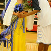 Enid High School basketball homecoming queen, Shannon Mueller (left) receives a traditional kiss from king, Darnae Banks, during half-time festivities at the Mabee Center Tuesday, Jan. 29, 2013. (Staff Photo by BONNIE VCULEK)