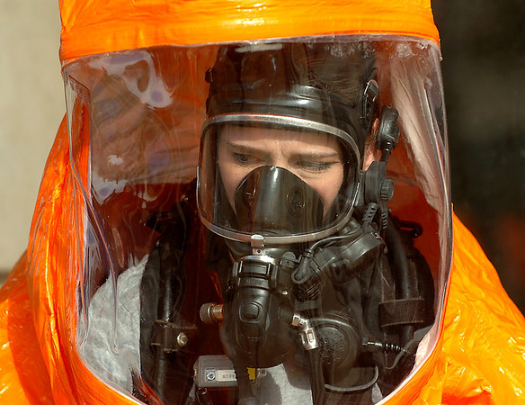 Oklahoma National Guardsman, Staff Sgt. Margie Capshew, of the 63rd Weapons of Mass Destruction Civil Support Team, in her hazmat suit during a joint exercise with the Enid Fire Department at the Garfield County Fairgrounds. (Staff Photo by BILLY HEFTON)