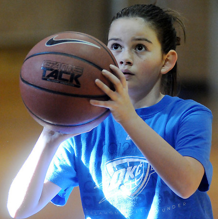 Kassidy Diel, a sixth-grade student at Chisholm, concentrates during the Knights of Columbus free throw shooting contest at St. Joseph Catholic School Saturday, Jan. 19, 2013. Boys and girls, from the age of 10-14, participated in the annual event. (Staff Photo by BONNIE VCULEK)