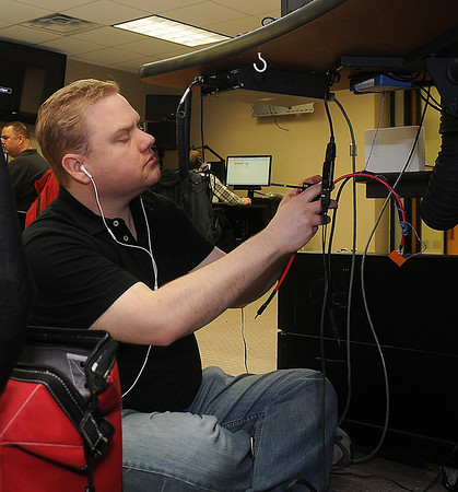 Richard Jordan, from Microdata in Denver, Col., connects the new phone lines during the 911 Communication Center update at Enid Police Department. (Staff Photo by BONNIE VCULEK)
