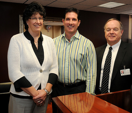 Kristy Petersen MD, Garrett Shelton MD, and Stan Tatum, Chief Executive Officer with St. Mary's Regional Medical Center, (from left) pause for a portrait in the hospital administrative office lobby Wednesday, Jan. 30, 2013. Dr. Petersen and Dr. Shelton will become physicians in the new hospitalist program at St. Mary's Regional Medical Center within the next few months. (Staff Photo by BONNIE VCULEK)