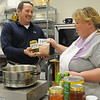 Linda Beguin (right), with Over the Fence Farms, hands Brian Gaddy one of the products that she produces at her incubator business in the James W. Strate Center for Business Development at Autry Technology Center Friday, Jan. 25, 2013. Gaddy is the center coordinator for new local businesses. (Staff Photo by BONNIE VCULEK)
