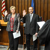 District Judge Paul Woodward swears in (left to right) Margaret Jones, county court clerk, Kathy Hughes, county clerk and Reese Wedel, county commissioner, Wednesday at the Garfield County Courthouse. (Staff Photo by BILLY HEFTON)