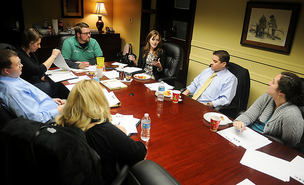 Enid Young Professionals discuss plans for the year during their first board meeting in the Dr. Jerry & Carolynne Blankenship Conference Room at the Cherokee Strip Regional Heritage Center Thursday, Jan. 17. (Staff Photo by BONNIE VCULEK)