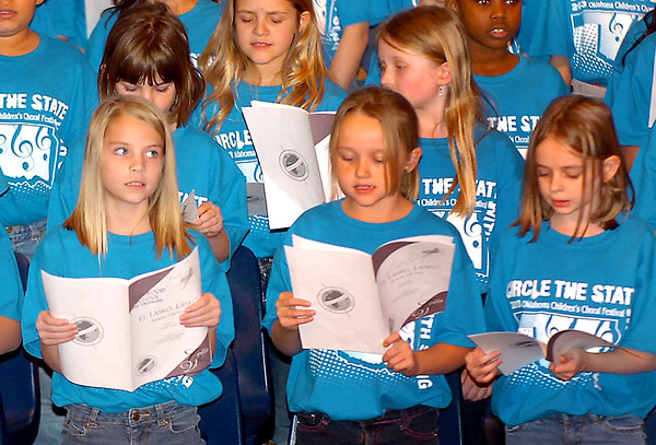 Students from schools across northwest Oklahoma perform during the 2013 Circle the State with Song Region B Choral Festival Tuesday at Emmanuel Baptist Church. (Staff Photo by BILLY HEFTON)
