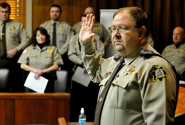 Newly elected Garfield County Sheriff, Jerry Niles, takes the oath of office Wednesday at the Garfield County Courthouse. (Staff Photo by BILLY HEFTON)