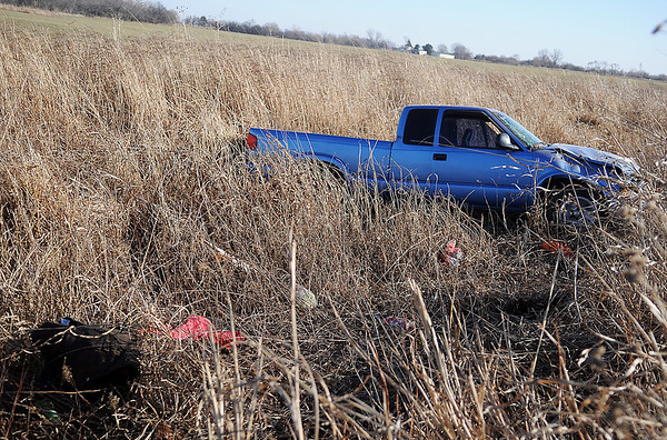 Clothing and groceries fill the roadside ditch on S. Leona Mitchell after the driver of a Chevrolet pick-up lost control of the vehicle during a rollover accident Sunday, Jan. 19, 2014. The driver was transported to a local hospital by Life EMS. The Oklahoma Highway Patrol, Garfield County Sheriff  Department, Enid Fire Department, Waukomis Fire & Rescue and Life EMS responded to the scene. (Staff Photo by BONNIE VCULEK)
