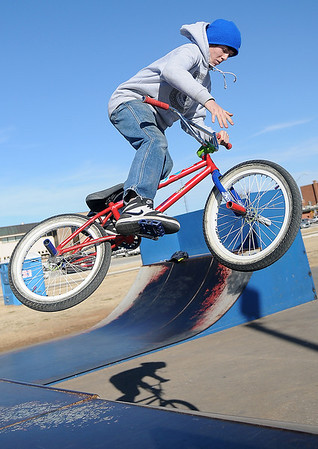Miles Preston does a tire tap as he catches air at the City of Enid skate park Monday, Jan. 20, 2014. (Staff Photo by BONNIE VCULEK)