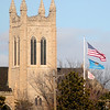 Bivins Chapel appears in the distance as flags flutter in the wind on the NOC-Enid campus Tuesday, January 28, 2014. (Staff Photo by BONNIE VCULEK)