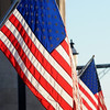 United States flags flutter in the wind in downtown Enid, honoring the late Dr. Martin Luther King, Jr. during the national holiday Jan. 20, 2014. (Staff Photo by BONNIE VCULEK)