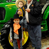 Gabe and Logan Sebranek pause for a portrait with Proud Poppy Chuck Sebranek during the KNID Agrifest at the Chisholm Trail Expo Center Friday, Jan. 10, 2014. (Staff Photo by BONNIE VCULEK)
