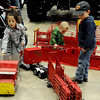 Children play with toys created by the Happy Toy Maker, Jerry Sims, during the 18th annual KNID Agrifest at the Chisholm Trail Expo Center Friday, Jan. 10, 2014. (Staff Photo by BONNIE VCULEK)