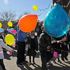 Balloons fly from the hands of Pre-K and fifth grade children as St. Joseph Catholic School students celebrate National Catholic Schools' Week with a balloon release. The owner of the balloon that travels the farthest and is returned will receive a prize. (Staff Photo by BONNIE VCULEK)