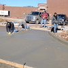 Employees from Major Concrete Inc. in Wichita, Kan. smooth the new concrete driveway entrance to Longfellow Middle School Thursday, Jan. 16, 2014. (Staff Photo by BONNIE VCULEK)