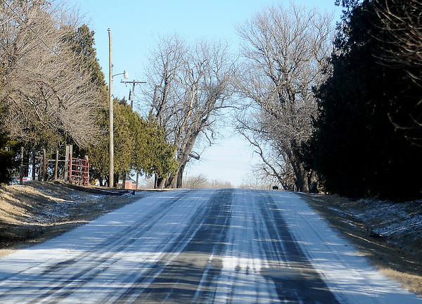 Ice remains on shaded road surfaces along Norman Road Tuesday, January 28, 2014. Residential areas and highways were slick and hazardous as drivers reported to work. Temperatures reached the low 30s, but sections of area road surfaces within Garfield County remained slick late Tuesday. (Staff Photo by BONNIE VCULEK)