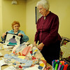 Carlene Perkins and Dee Taylor discuss the different types of quilting patterns during the Cherokee Strip Regional Heritage Center family Saturday activities Jan. 18, 2014. (Staff Photo by BONNIE VCULEK)