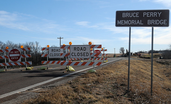 The Oklahoma Department of Transportation closed OK 132, 4 miles north of Drummond, as crews demolish and replace the Bruce Perry Memorial Bridge over Turkey Creek Wednesday, Jan. 15, 2014. Completion of the new bridge is slated for May 2014. Individuals living in the area have access to other county roads during construction. (Staff Photo by BONNIE VCULEK)