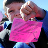 Adrian, a first-grade student at St. Joseph Catholic School, shares the letter attached to his balloon, before more than 90 children at St. Joseph Catholic School release their balloons during National Catholic Schools' Week Wednesday, Jan. 29, 2014. (Staff Photo by BONNIE VCULEK)